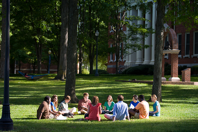 Students sitting on the grass in a circle